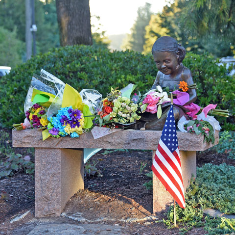 Each year on September 11, flowers are left at the memorial for Amy Toyen outside the Avon Free Public Library.